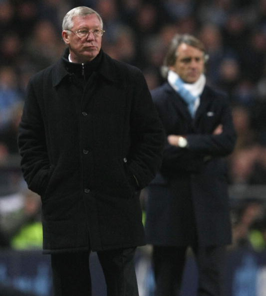 Ferguson's Mancheter United lead the title race